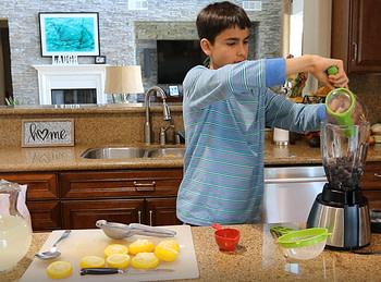 toby making blueberry lemonade