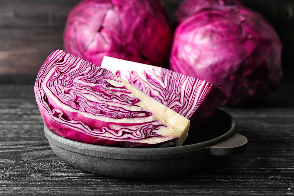 Whole and quarted red cabbage